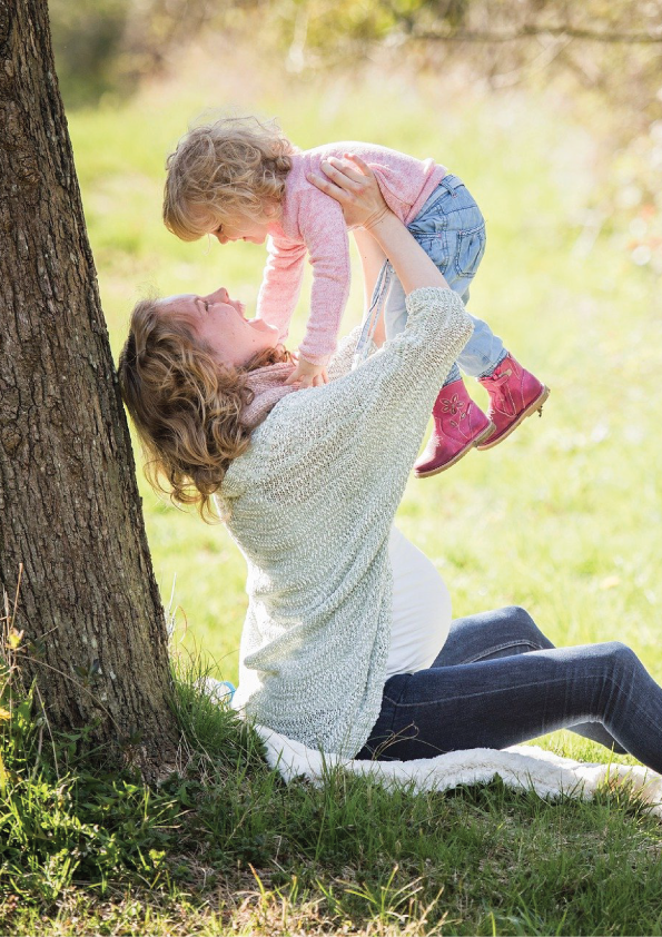 Happy mother playing with her healthy child after doing online prenatal yoga training